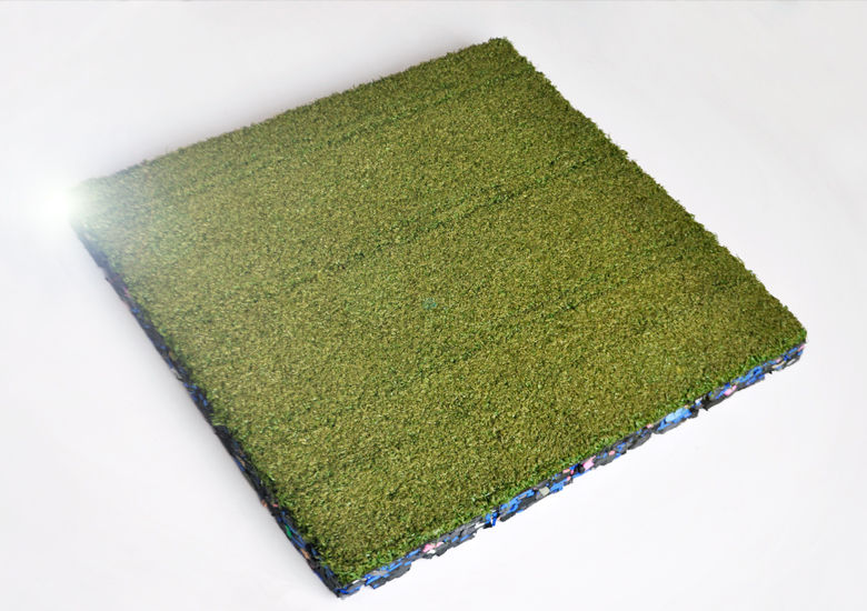 Green astroturf square tile on white background