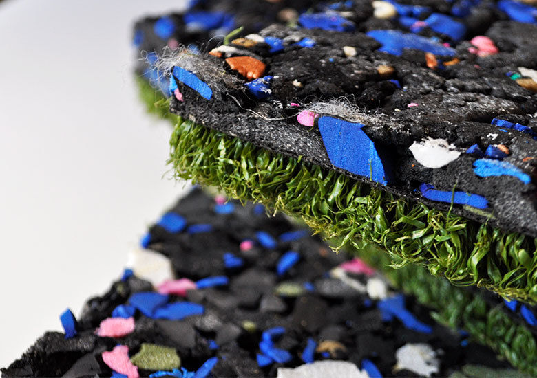 Multi colour cross-linked closed cell polyethylene foam with a green astroturf base.